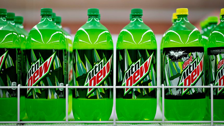Bottles of PepsiCo Inc. Mountain Dew brand soda sits on display in a supermarket in Princeton, Illinois, U.S., on Friday, Oct. 12, 2012. PepsiCo Inc. is scheduled to release earnings data on Oct. 17. Photographer: Daniel Acker/Bloomberg via Getty Images